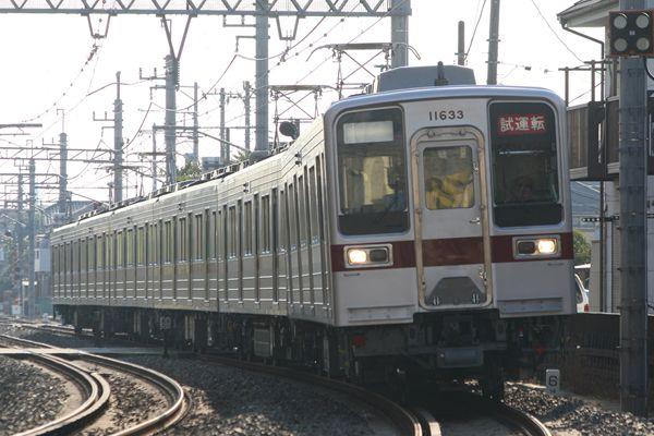 11633F