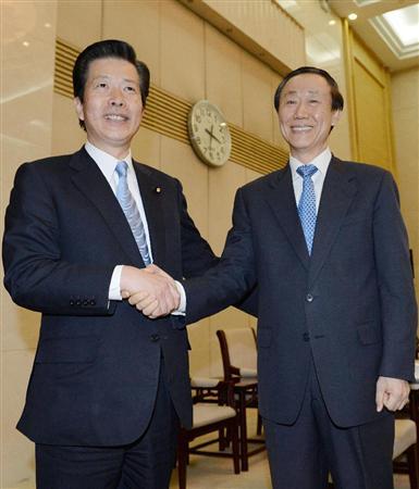 a 中国共産党の王家瑞中央対外連絡部長