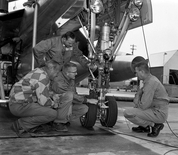 crew-inspecting-plane-prior-to-take-off-photograph-april-5-1962.jpg